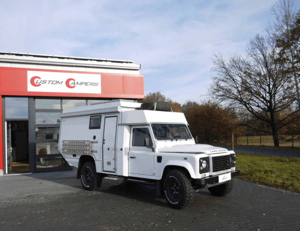White Land Rover Defender 130 with Custom Camper